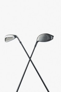 Close-up of two golf clubs